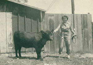 Mom with her first Angus heifer, Suzie, in 1953.