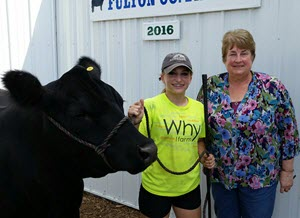 Emily with the buyer of her steer Waldo at the County Fair